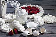 Meringues, meringue tart and meringue ingredients on grey wood - CSF021024