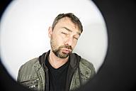 Portrait of man through peephole - MAEF008204