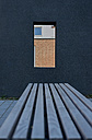 Germany, North Rhine-Westphalia, Aachen, dark facade and bench in front - HL000430