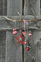 Deer antler and Christmas decoration on wooden wall - ASF005286