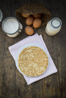 Pancake on plate and ingredients, eggs, milk and flour - LVF000886