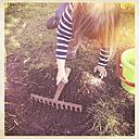 Girl working in the garden - LVF000875