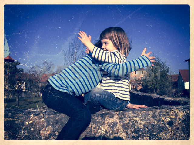 Germany, Baden-Wuerttemberg, girl on a wall - LVF000862