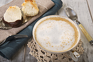 Two coco macaroons on cake server and cup of milk coffee - CSTF000186