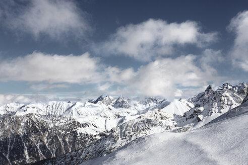 Austria, Vorarlberg, Riezlern, Mountainscape in winter - MUM000060