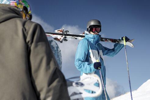 Austria, Vorarlberg, Riezlern, Skier in the mountains - MUM000062