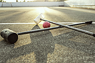 Germany, Hannover, Bike polo sticks lying on ground - MUMF000075