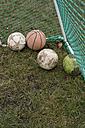 Germany, Bavaria, St Leonhard, Soccer goal and old footballs - ASF005302