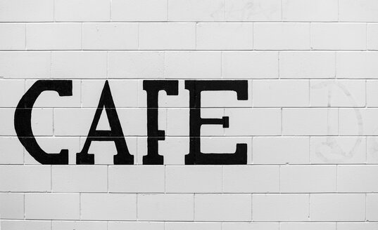 New Zealand, Ngatea, the word Cafe on white brickwork - WV000505