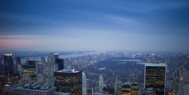 USA, New York, Manhattan, view to lighted skyline at evening twilight - JWAF000013