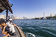 United Arab Emirates, Dubai, Boat in water and skyline of city center - THA000175