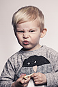 Portrait of little boy pouting a mouth - MFF000921