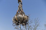 Clamshell grabbing electrical waste at a scrap metal recycling plant - LAF000833