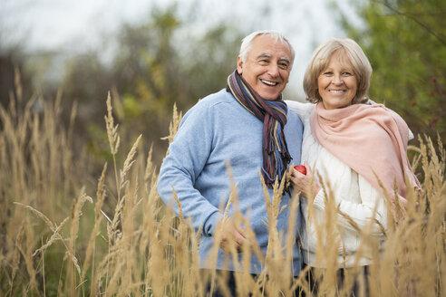 Portrait of happy senior couple having a walk - WESTF019202