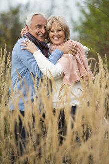 Portrait of happy senior couple embracing - WESTF019208