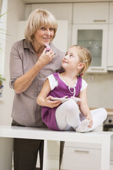 Little girl and her grandmother in kitchen - WESTF019125
