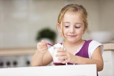 Portrait of little girl eating yogurt - WESTF019114