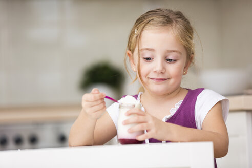 Portrait of little girl eating yogurt - WESTF019114