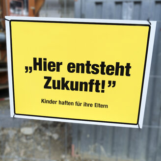 Sign on a fence, photomontage, Freiburg, Germany - DRF000599