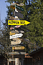 Germany, Bavaria, Inzell, sign post forest - YF000073