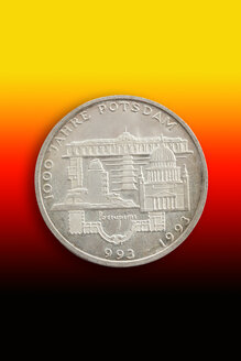 Old German commemorative coin in front of national colours - CSF021097