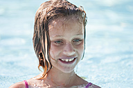 Italy, Tuscany, Wet girl in swimming pool - PAF000570