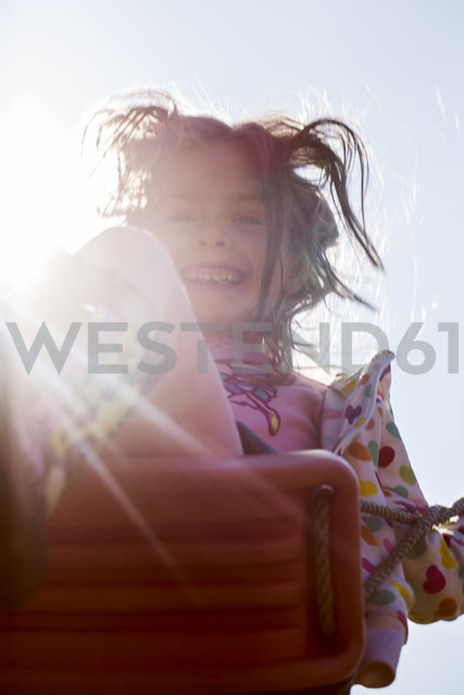 Portrait of smiling little girl on swing - SARF000422