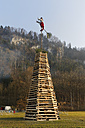 Austria, Vorarlberg, Rhine Valley, Hohenems, wood tower with witch for bonfire - SIEF005199