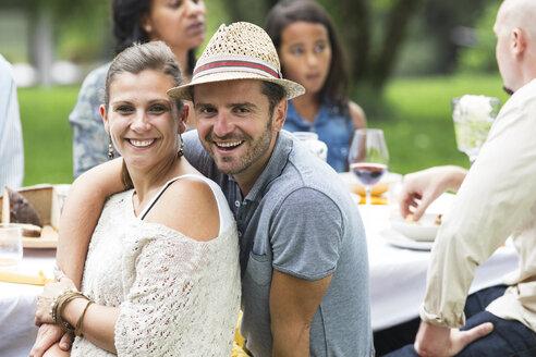 Happy couple on a garden party - ABF000591
