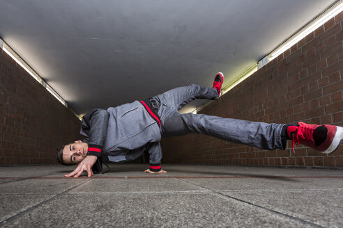 Germany, portrait of young break dancer in underpass - STS000371