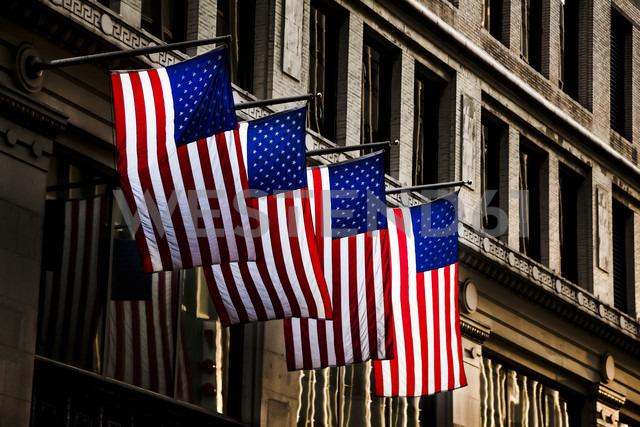 USA, four American flaggs at facade - DISF000693