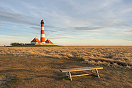Germany, Schleswig-Holstein, North Sea Coast, View of Westerheversand Lighthouse in the evening - RJ000061