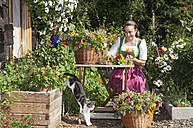 Austria, Altenmarkt, Farmer's woman binding bouquets - HHF004786