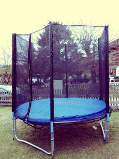 Trampoline in the garden, Huglfing, Bavaria, Germany - RIM000218