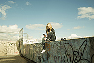 Germany, Mannheim, Young woman at skate park - UUF000053