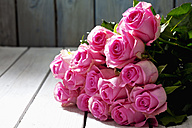 Bunch of pink roses on grey wood - CSF021115