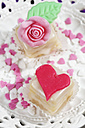 Two petit four and baking decor on cake stand - CSF021158