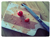 Vine tomatoes on a wooden board, studio - MYF000272