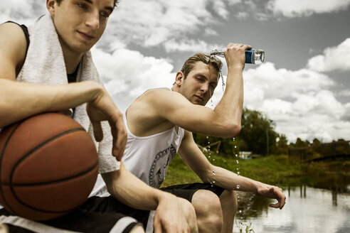 Portrait of two young basketball players having a rest - GCF000009