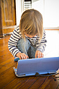 Little girl using toy computer - LV000949
