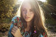Portrait of female teenager at backlight - LFOF000175
