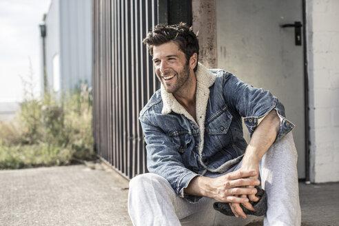 Portrait of laughing man wearing denim jacket - MUMF000042