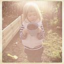 Germany, Baden-Wuerttemberg, girls planting, garden - LVF000938
