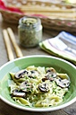 Homemade kale and walnut pesto ravioli with mushrooms and vegan cheese and chives - HAWF000031