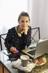 Young woman working with laptop at home - EBSF000148