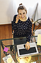 Young woman working with laptop at home - EBSF000137
