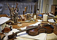 Tools and damaged instruments in a violin maker's workshop - DIKF000103