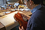 Violin maker at work in his workshop - DIKF000117