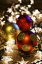 Three Christmas baubles and tangled Christmas lights - HAWF000017
