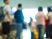 UAE, Dubai, travellers waiting at airport - DIS000702